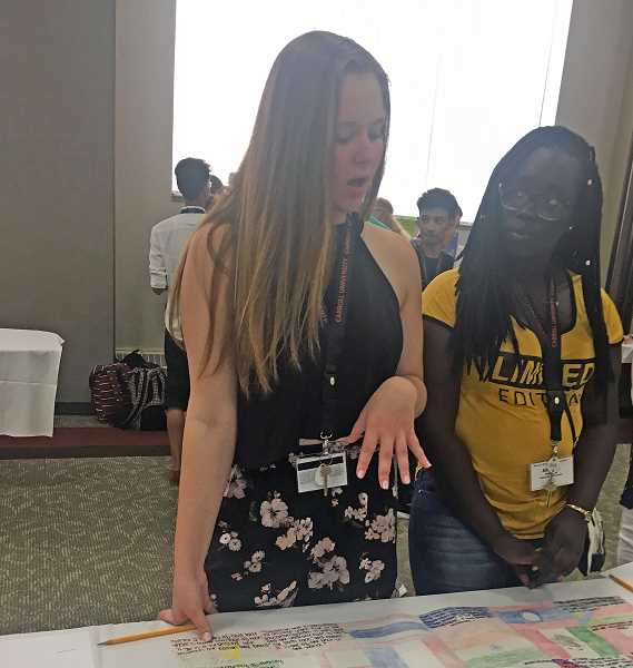 SUBMITTED PHOTO - Chloe Leeper (left), an incoming senior at Lake Oswego High School, chats with a fellow World Affairs Seminar attendee.