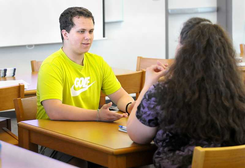 SETH GORDON - Newberg High School student Lucas Weaver goes through an exercise as part of a QPR (Question, Persuade, Respond) suicide awareness training seminar offered to parents and students June 1.