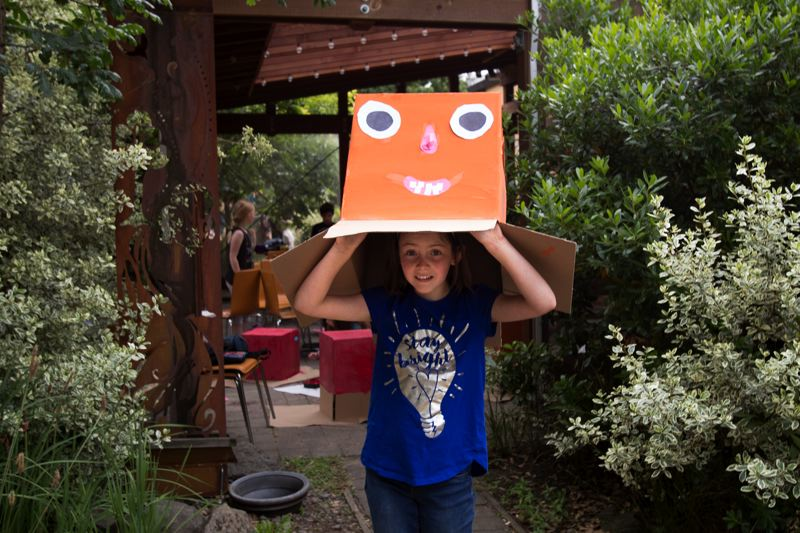 PORTLAND TRIBUNE: JAIME VALDEZ - Lucy Morse, 10, wears a camera obscura she made at Vibe of Portland, a family art studio at Tabor Commons.