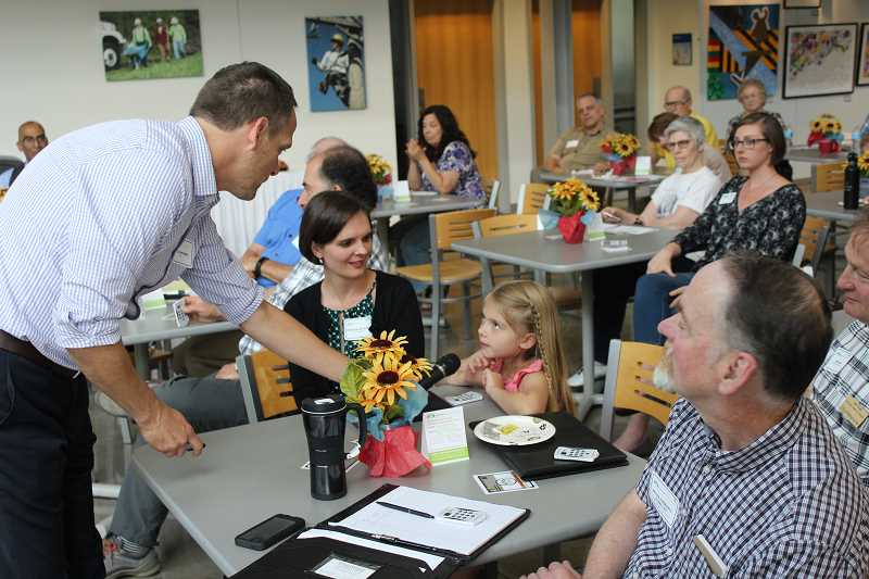 SPOKESMAN PHOTO: ANDREW KILSTROM - Odessa Akervall gives her input on bike lanes at the Wilsonville Town Center open house Monday, June 26 at Clackamas Community College.