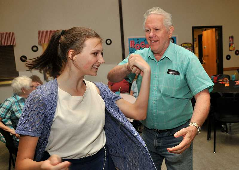 Steve VanWechel  enjoys swinging with his daughter Jessica VanWechel at Soda Shop Rocks dance in Wilsonville June 29.