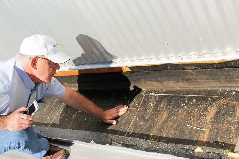 CONTRIBUTED PHOTO - The work on Clackamas River Elementary School's roof includes repairing several of its raised sections.