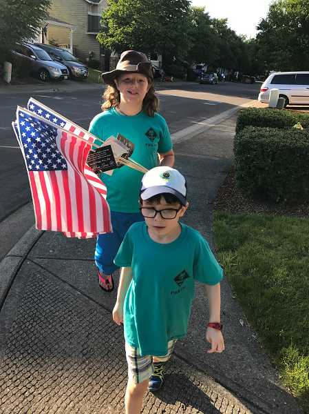 SUBMITTED PHOTO - Cub Scouts march through Wilsonville streets Thursday, June 29.