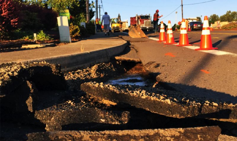 PHOTO COURTESY OF CLACKAMAS COUNTY SHERIFFS OFFICE - The sinkhole is near the busy intersection by the Safeway store in Damascus.