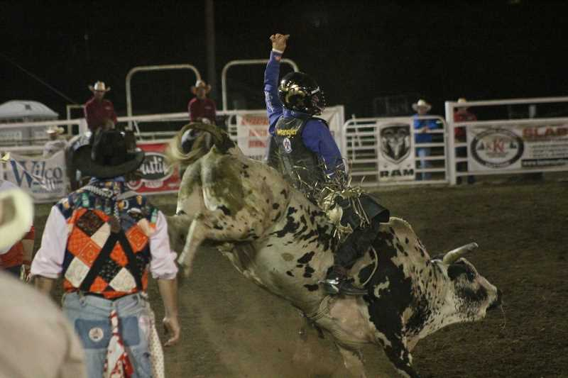PIONEER PHOTO: CONNER WILLIAMS  - Sage Kimzey, reigning world champion bull rider, earned 82 points Monday night to take second place so far.