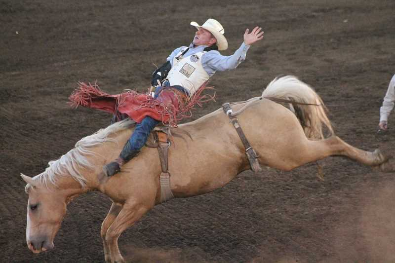 PIONEER PHOTO: CONNER WILLIAMS  - Bill Tutor was the only athlete to compete in the bareback riding Monday night, but that didn't stop him from sliding into second place with a 76.5 point ride.