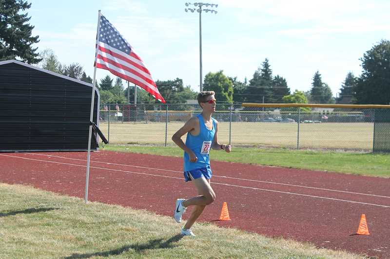PIONEER PHOTO: CONNER WILLIAMS  - Marcus David, 15, won the sixth annual Freedom 5K race in 17 minutes, 30 seconds.
