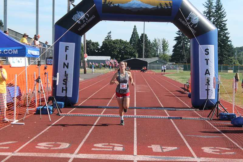 PIONEER PHOTO: CONNER WILLIAMS  - Hannah Clarizio, 20, of Molalla, finished 14th overall and fifth among the women as she clocked a 19:54, beating her time from last year by 44 seconds.
