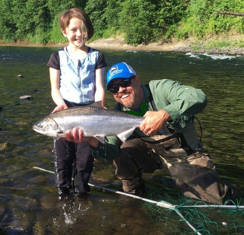 9-year-old Ava Shibahara landed this Clackamas River spinner-caught spring Chinook in June, out-fishing both dad Tim (not pictured) and his fellow PGE fish biologist friend Garth Wyatt. (The fish was promptly released).