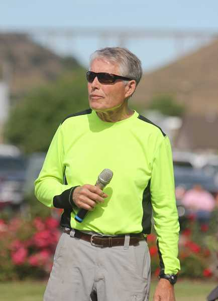 WILL DENNER/MADRAS PIONEER - Bud Beamer addresses runners and walkers during the awards ceremony Tuesday morning.