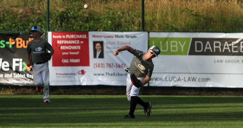 REVIEW PHOTO: MILES VANCE - Lakeridge center fielder Spencer Gore makes a throw during his team's pool play loss to Sunset in the Firecracker Classic tournament at Lakeridge High School on Friday.