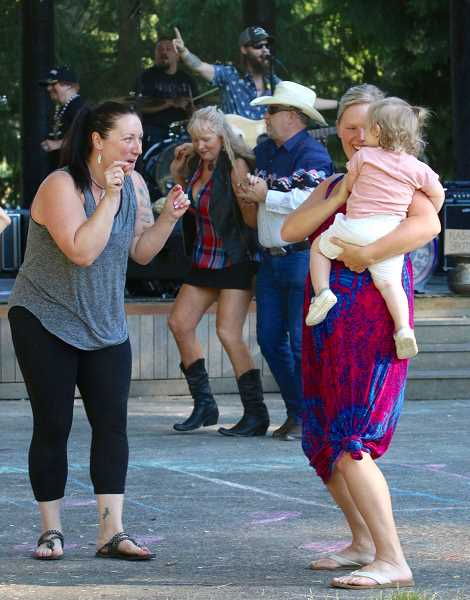 PHOTOS BY J. BRIAN MONIHAN -  Dancers hit the stage at Willamette Park during Fourth of July festivities.