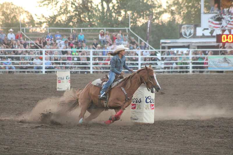 PIONEER PHOTOS: CONNER WILLIAMS - Molalla's own Rachel Stoller took sixth in the barrels with a time of 17.62 seconds.