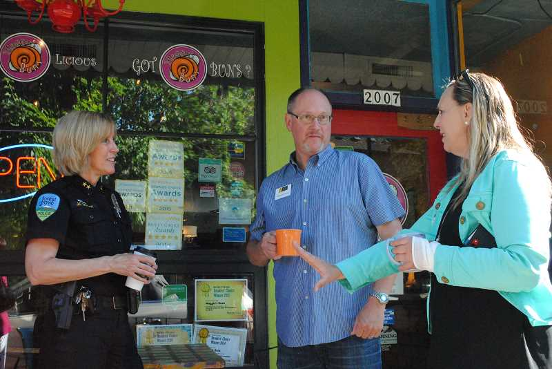 NEWS-TIMES PHOTO: EMILY GOODYKOONTZ - Police Chief Janie Schutz talks with real estate agents outside Maggies Buns at the Coffee With a Cop event on Wednesday, July 5.