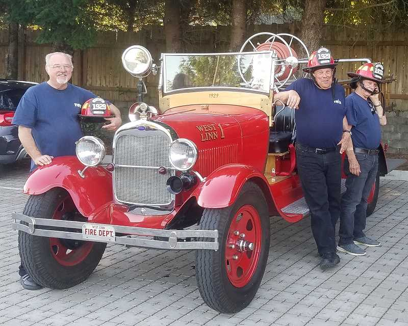 Bill Barges and crew show a classic antique fire truck