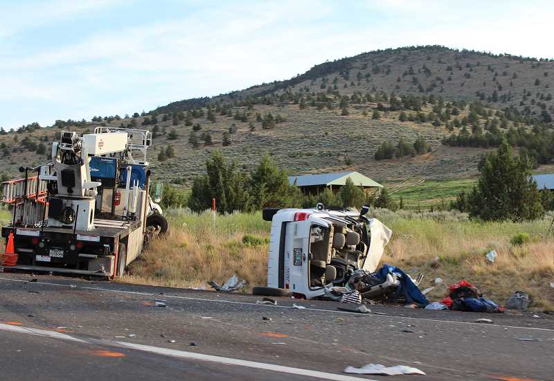 HOLLY M. GILL - A Ford Escape car and large Carlson Sign Co. truck collided near the intersection of U.S. Highway 97 and the Culver Highway on Friday, June 30. The driver of the Ford Escape was injured, and a 9-month-old baby died at the scene.