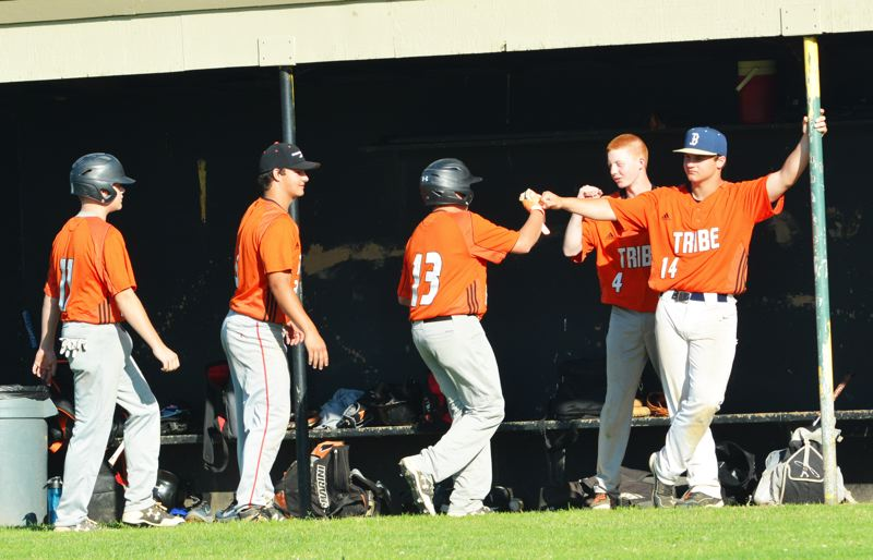 SPOTLIGHT PHOTO: JAKE MCNEAL - From left, the Indians' Breeler Mann (11), Thomas Cook of Banks, playing with Scappoose for the summer, Noah Packineau (13), Jordan Buchanon (4) and Bryson Cook (14, also of Banks) celebrate in Scappoose's 1-0 win on Wednesday in St. Helens.