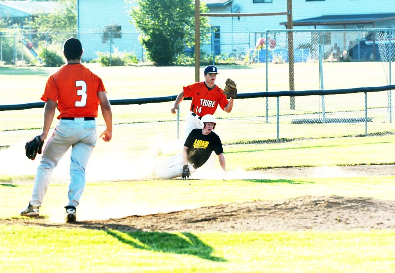 SPOTLIGHT PHOTO: JAKE MCNEAL - Bryson Cook of Banks (14) makes a tag at third base.