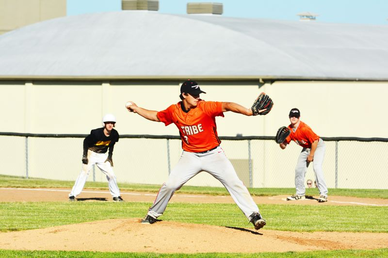 SPOTLIGHT PHOTO: JAKE MCNEAL - Thomas Cook of Banks, center, readies a pitch.