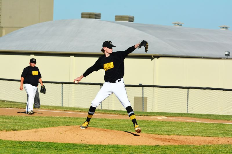 SPOTLIGHT PHOTO: JAKE MCNEAL - Lions pitcher Owen Wolfe winds up.