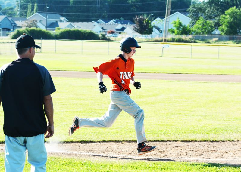 SPOTLIGHT PHOTO: JAKE MCNEAL - Scappoose's Jordan Buchanon races a throw to first base.