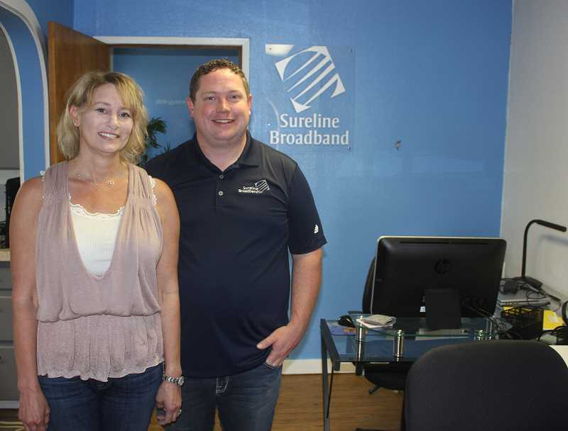 SUSAN MATHENY - Shelly and Josh Richesin are working on installing upgrades to the Sureline Broadband system they have headquartered in Madras.