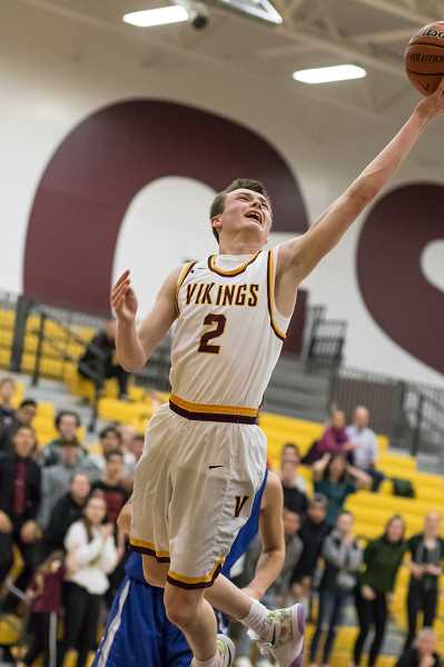 NEWS-TIMES FILE PHOTO: CHASE ALLGOOD - Forest Grove's Bailey Evers goes up for a lay-in during a game last season. Evers will be playing basketball at Linn Benton Community College this fall.
