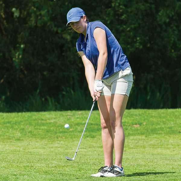 COURTESY PHOTO - Hilhi's Makenna Gambee hits a chip shot during a golf match. Gambee qualified for this year's state regional at Trysting Tree Golf Course in Corvallis.