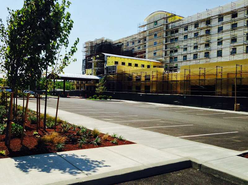 PAMPLIN MEDIA FILE PHOTO - The Embassy Suites hotel on Northwest Tanasbourne Drive under construction in 2014 in Hillsboro. The city could begin taxing hotels as soon as Aug. 17.