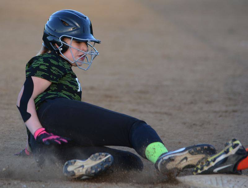 ESTACADA NEWS: DAVID BALL - Estacadas Jessi Ott slides safely into third base during the Rangers 9-9 tie with Gladstone in Sundays third-place game.