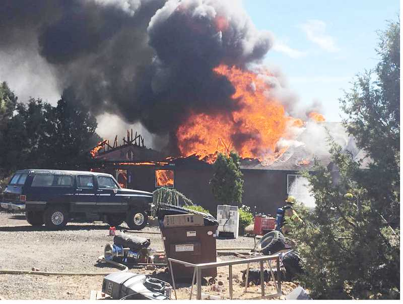 SUBMITTED PHOTO - The residents of a home on Platiro Court on Juniper Butte, Leilani Platiro and Micah Bodenlos, were on vacation when a fire started in their home, and left it a total loss.