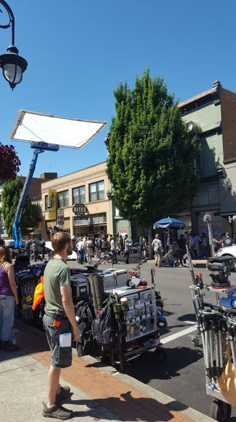 NEWS-TIMES PHOTO: EMILY GOODYKOONTZ - Main street filled with the cast and crew of 'The Librarians' as an episode was filmed in downtown Forest Grove on Thursday, July 6.  Overhead a giant sun-screen shades the action.