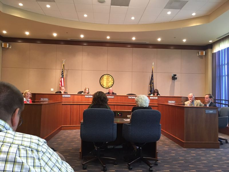 PAMPLIN MEDIA GROUP: PETER WONG - Lisa Adatto of Lake Oswego, left, and Sandy Polishuk of Portland testify on a climate-change resolution Thursday, July 6, at a meeting of Clackamas County commissioners