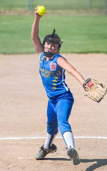 LON AUSTIN/CENTRAL OREGONIAN - Jaycee Villastrigo delivers a pitch during the Cowgirls' win over Redmond on Wednesday.