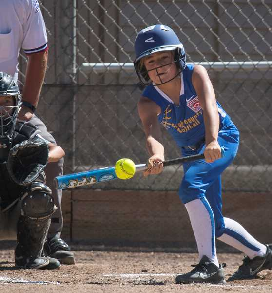 LON AUSTIN/CENTRAL OREGONIAN - Kamryn Ackley lays down a perfect bunt for a hit against Redmond. Crook County won the game 19-5 earning a trip to the state tournament, which will start next Friday in Medford.