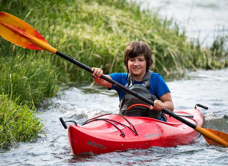 LON AUSTIN/CENTRAL OREGONIAN - Twelve-year-old Shiloh Binder finishes the kayak portion of the event.