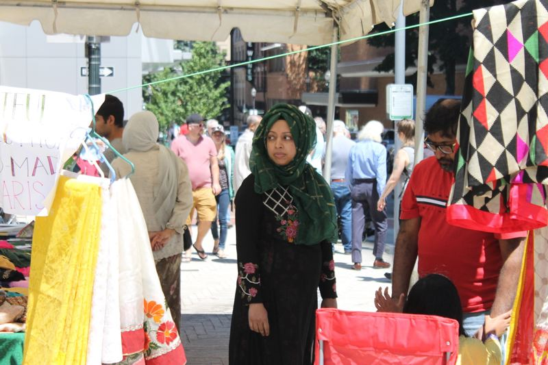 TRIBUNE PHOTO: LYNDSEY HEWITT - A woman sells hijabs at the Muslim festival.