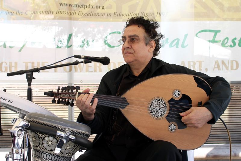 TRIBUNE PHOTO: LYNDSEY HEWITT - A member of the Al Andalus Ensemble plays an oud, a traditional Arab musical instrument considered to be the grandfather of the guitar and mandolin.