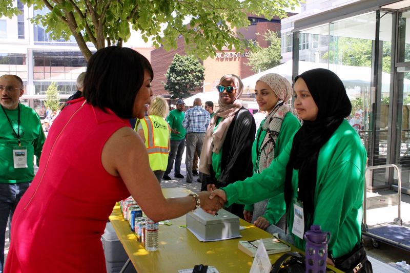 TRIBUNE PHOTO: LYNDSEY HEWITT - Multnomah County Commissioner Loretta Smith meets with volunteers at the Portland International Muslim Festival on Saturday, July 8.