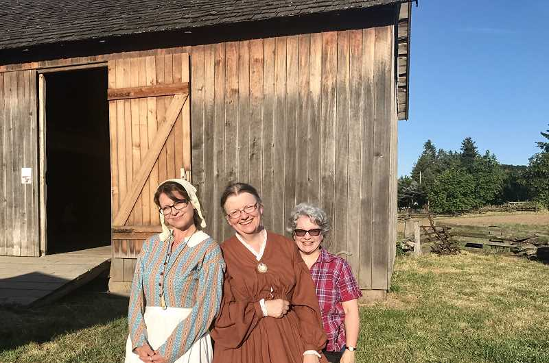 SPOKESMAN PHOTO: MADISON STATEN - Emily-Rose Rosewood (Left), Kay Demlow and Chris Myers pose in front of the threshing barn at Champoeg State Park.