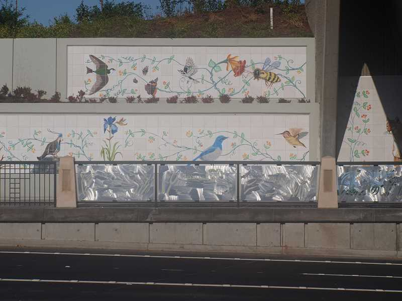 SUBMITTED PHOTO - A look at the raised sidewalks and student artwork installed during phase one of the Beauty and the Bridge project.