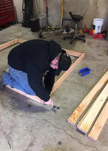 SUBMITTED PHOTO - Mathew McCulloch puts together the frames for concrete shooting platforms as part of his Eagle Scout qualifying project.