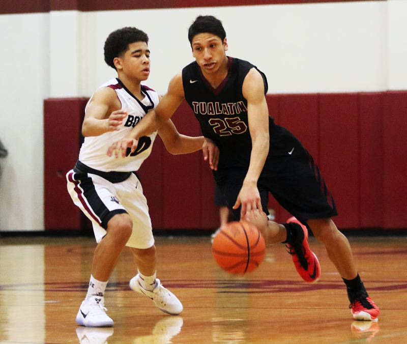 DAN BROOD - Sherwood freshman Jamison Guerra (left) and Tualatin junior Alexis Angeles battle in a TRL game last year. The Bowmen and Timberwolves could be in different leagues in the future.