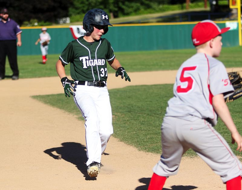 DAN BROOD - Tigard's Konner Grant races to third base during action in Saturday's game at the District 4 tournament.