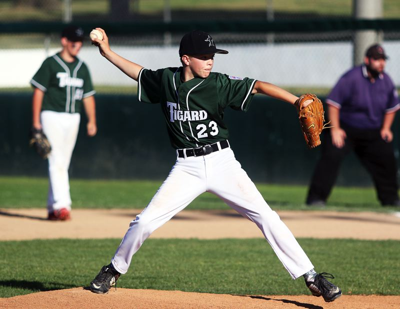 DAN BROOD - Tigard's Brady Jordan gets ready to let loose with a pitch during Saturday's game at the District 4 tournament.
