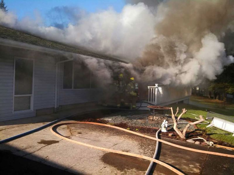 COURTESY OF COLUMBIA RIVER FIRE & RESCUE - Firefighters in Columbia County credited working smoke alarms from keeping this 2013 residential fire from causing any injuries. Tualatin Valley Fire & Rescue also emphasizes the importance of smoke detectors.