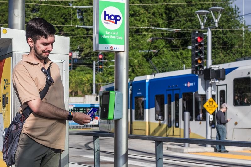 TRIBUNE PHOTO: JONATHAN HOUSE - Stephen Weber had been beta testing the Hop Fastpass for TriMet since March. An IT professional himself, he's excited to see how TriMet might use data from the new card to improve its transit systems.