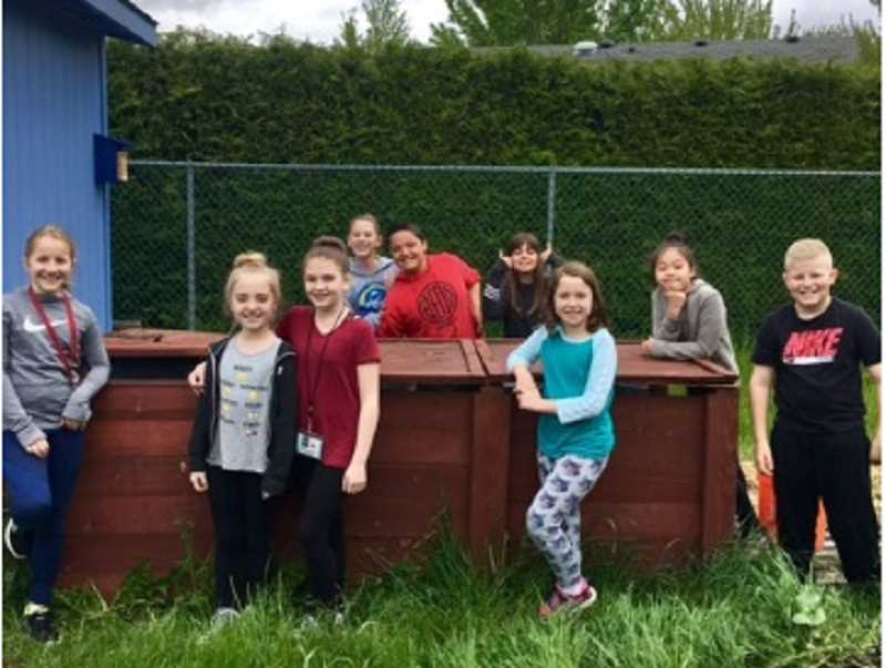 COURTESY OF MARIKA CONRAD - Fourth- and fifth-graders in Hopkins Elementary's Compost Club who compost 30 pounds of  food waste every school day include (from left) Lia Wagner, Mia Fandrey, Rosalind Young, Brynna Lee, Max Ellerton, Abby Gibson, Abby Jernstedt, Tylee Sarano Pestana and John Sutton.