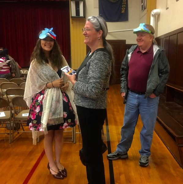 PHOTO COURTESY: MARTIN WINCH - Proud graduate Damica Waterman at the Twilight graduation ceremony with her parents in the North Clackamas School District.