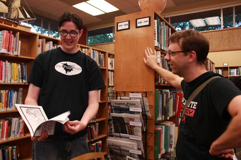 PHOTO BY KELLE KORPI - Matt Haynes, left, founder and artistic director of The Pulp Stage, chats with a fan at last year's event at the Ledding Library.